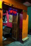 Tattoo Parlor, Shop, Small Business. A tattoo parlor. Small business where people go to get tattoos and their skin inked with graphic designs and pictures stock photo