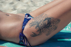 Tattoo. Photoshoot in geger beach bali indonesia royalty free stock image