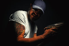 Tattoo And Pistol Stock Photography