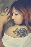 Tattoo. Portrait of stylish young woman with tattoo royalty free stock image