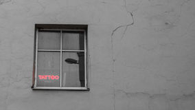 Tattoo red light sign on a window in an old building Royalty Free Stock Photography