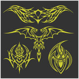 Tattoo set in tribal style on dark background. Symmetric tattoo set in tribal style on dark background Royalty Free Stock Image