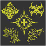 Tattoo set in tribal style on dark background. Symmetric tattoo set in tribal style on dark background Stock Image