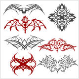 Tattoo set in tribal style on white background Royalty Free Stock Photo