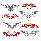 Tattoo set in tribal style on white background. Symmetric tattoo set in tribal style on white background Stock Photos