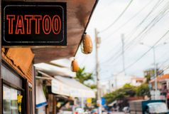 Tattoo with a sign on the street royalty free stock photography