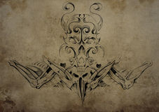 Tattoo skull over vintage paper, black tribal tattoos Royalty Free Stock Photography