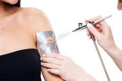 Tattoo sprayer Stock Images