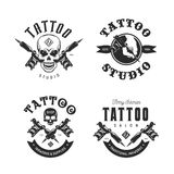 Tattoo studio emblems set. Vector vintage illustration. Tattoo studio emblems set. Hand holding tattoo machine. Human skulls outline drawing. Tattoo shop Royalty Free Stock Photos