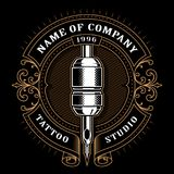 Vintage tattoo studio emblem_1 for dark background. Tattoo studio logo template. Vintage style frame with tattoo machine. Text is on the separate layer. Version Royalty Free Stock Photos