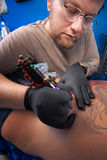 Tattoo Technician at Work Royalty Free Stock Images