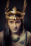 Tattoo, Warrior woman with gold mask, long hair brunette. Long h Royalty Free Stock Photography