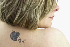 Tattoo of a woman Stock Photos