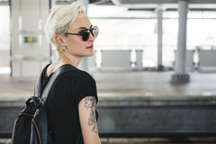 Tattoo Woman Style Glamour Alternative Lifestyle Concept. A young tattoo fashion woman commute city life Royalty Free Stock Image