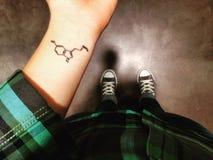 Tattoo. Wrist tattoo, serotonin chemical breakdown Royalty Free Stock Photo