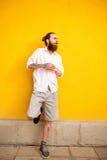 Tattooed bearded attractive man on yellow wall Stock Image