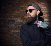 Tattooed bearded male in military jacket. Royalty Free Stock Photo