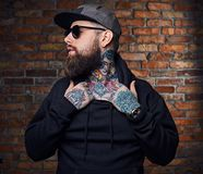 Tattooed bearded male in military jacket. Royalty Free Stock Image