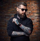 Tattooed bearded male in military jacket. Royalty Free Stock Photography