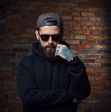 Tattooed bearded male in military jacket. Stock Photo
