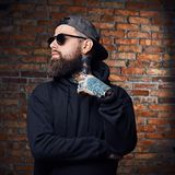 Tattooed bearded male in military jacket. Stock Images