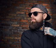 Tattooed bearded male in military jacket. Stock Image