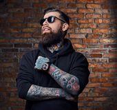 Tattooed bearded male in military jacket. Stock Photography