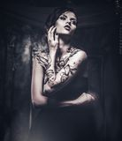 Tattooed beautiful woman Stock Images