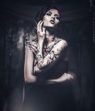 Tattooed beautiful woman Stock Images