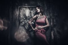 Tattooed beautiful woman. In old spooky interior Stock Image