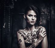 Tattooed beautiful woman Stock Photo