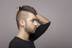 Tattooed boy with mohawk. Royalty Free Stock Photo