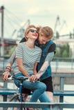 tattooed boyfriend and smiling stylish girlfriend stock photography