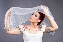 Tattooed Bride with veil. Tattooed Bride bride with veil over her head Royalty Free Stock Photo