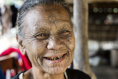 Tattooed faced Chin Tribe Woman, Myanmar. Mrauk-U, Myanmar - January 30, 2016. A portrait of Chin tribe woman with spider tattoo on her face. Chin people, also royalty free stock photos