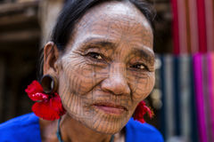 Tattooed faced Chin Tribe Woman, Myanmar. Royalty Free Stock Photo