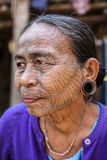 Tattooed faced Chin Tribe Woman, Myanmar. Mrauk-U, Myanmar - January 30, 2016. A portrait of Chin tribe woman with spider tattoo on her face. Chin people, also royalty free stock photo