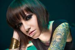 Tattooed girl in studio Stock Photo