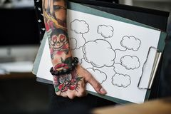 Tattooed hand holding a blank paper clipboard. Tattooed hand holding an empty cloud clipboard royalty free stock image