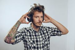 Tattooed hipster man with headphones Stock Photography