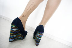Tattooed legs Royalty Free Stock Photography