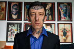 Tattooed man in black jacket and shirt Stock Image