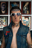Tattooed man in denim vest and sunglasses Royalty Free Stock Image