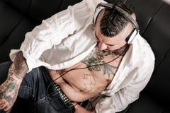 Tattooed man on the sofa Stock Photo
