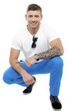 Tattooed man in squatting position Royalty Free Stock Images
