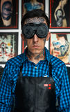 Tattooed man in welder glasses and shirt Stock Photography