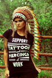 Tattooed model with indian headdress Stock Photo
