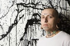 Tattooed and pierced man. Stock Photography