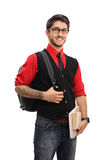 Tattooed student with a backpack and books Royalty Free Stock Photo