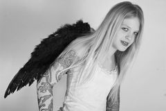 Tattooed teenager with wings Stock Photo